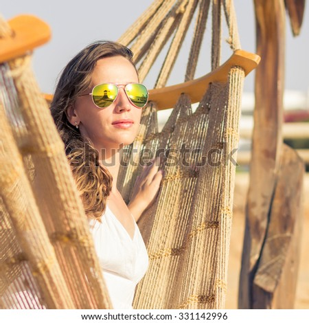 Young beauty woman drinking coffee in a cafe outdoor. Elegant caucasian girl enjoying her latte in the morning - stock photo