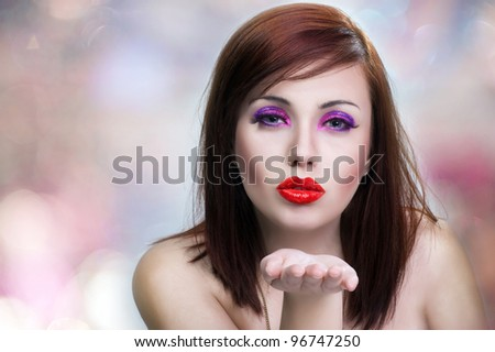Young beauty woman holding her hand palm up, ready to hold produ - stock photo