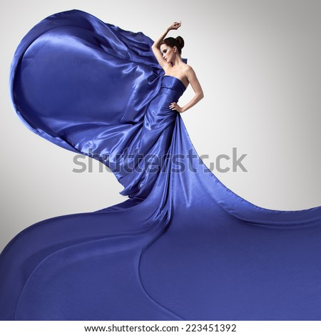 Young beauty woman in fluttering blue dress. - stock photo