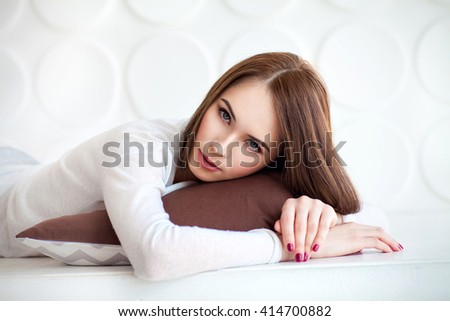 Young beauty woman lying down with pillow in the morning