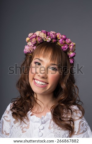 Young beauty woman portrait. Studio shot. Girl with Flower wreath. Grey background - stock photo