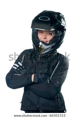 Young beauty woman posing in black motorcycle clothing and helmet.  Isolated on white. - stock photo