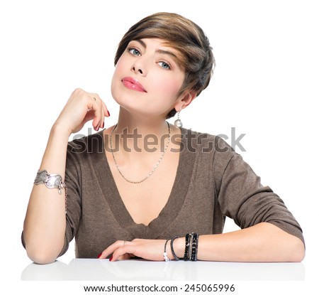 Young beauty woman with short bob hairstyle, beautiful make up, fresh skin, wearing accessories, isolated over white background. Portrait of attractive modern girl with brown short hair. - stock photo