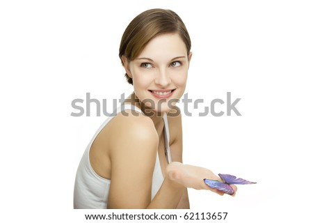 young beautyful woman with butterfly on her hand - stock photo