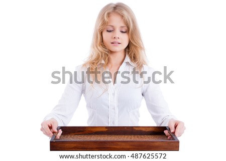 young beuatiful blond waitress with a tray, looking down, isolated