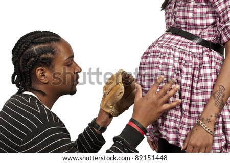Young black African American man and pregnant woman expecting a baby - stock photo