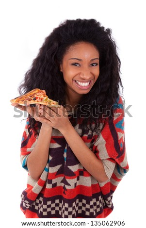 Young black african american teenage girl eating a slice of pizza, isolated on white background - african people - stock photo