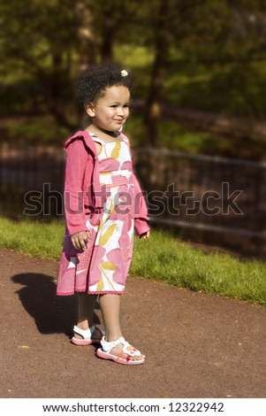 Young black baby girl smiling - stock photo