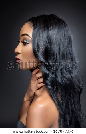Young black beautiful woman with elegant curly hair - stock photo