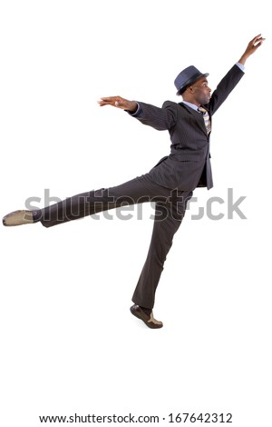 young black businessman in a suit dancing