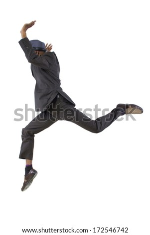 young black businessman leaping / jumping high - stock photo