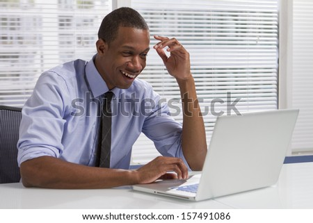 Young black businessman reading emails, horizontal