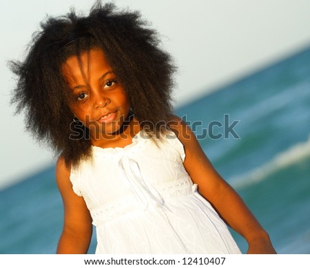 Young black girl in a white dress - stock photo