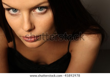 young black hair woman portrait on dark background - stock photo