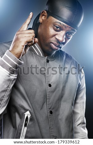 young black man in studio making hand sign