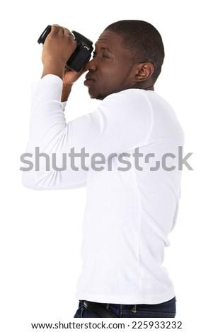 Young black man photographer doing photos - stock photo
