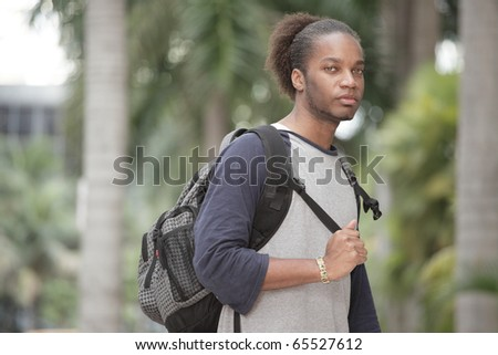 Young black man with a backpack - stock photo