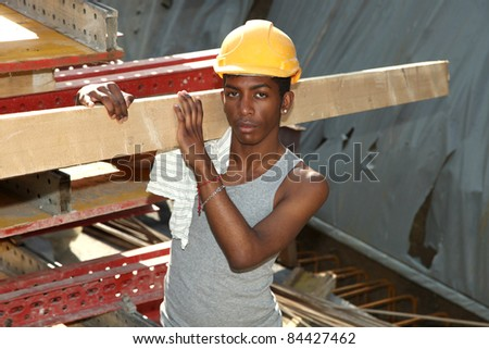 young black man working in construction site