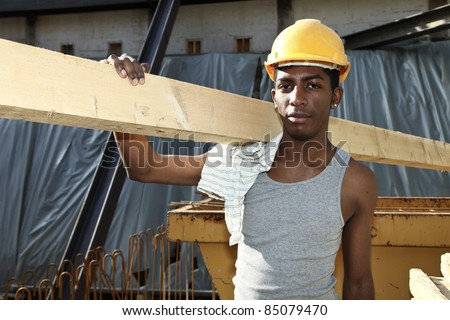 young black man working in construction site - stock photo
