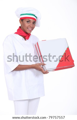 young black pizza cook showing pizza packets - stock photo