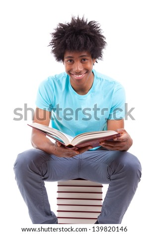 Young black teenage student men reading a books, isolated on white background - African people - stock photo