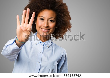 young black woman doing number four gesture
