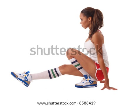 young black woman in red shorts stretching out