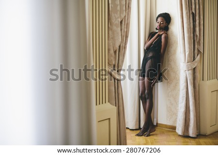 Young black woman in the room - stock photo