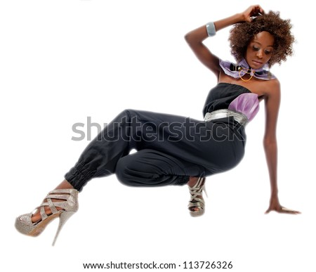 Young black woman putting her left foot forward as she squats down on the floor and isolated on a white background. - stock photo