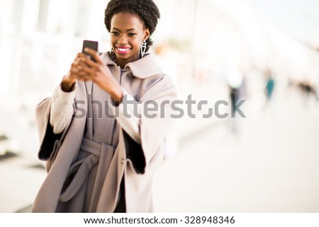 Young black woman taking selfie outdoor - stock photo