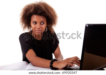 young black women working on desk looking to computer, isolated on white background. Studio shot. - stock photo