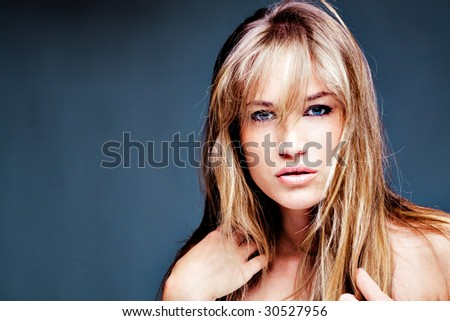 young blond blue eyes woman portrait - stock photo