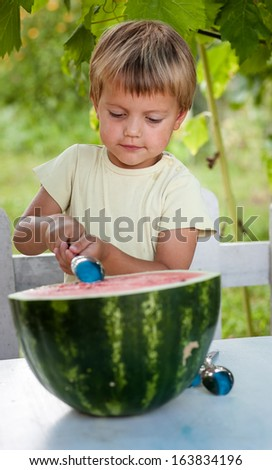 Young blond boy has healthy eating habits - stock photo