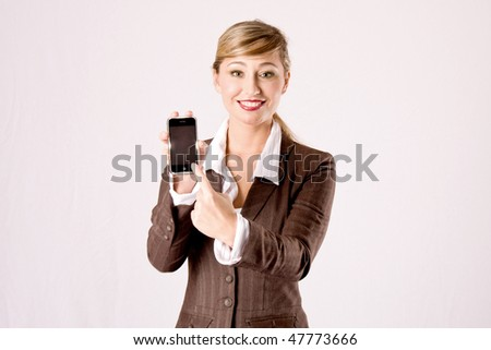 young blond business woman with cell phone - stock photo