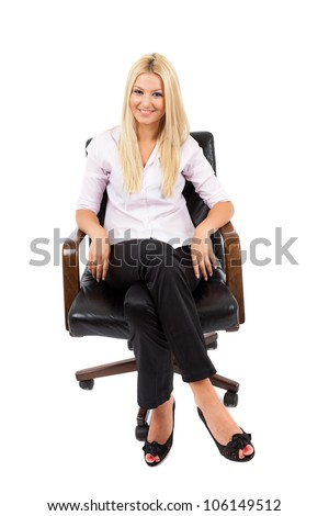 Young blond businesswoman in a chair isolated on white background
