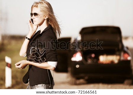 Young blond calling for help - stock photo