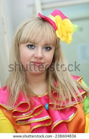 young blond clown actress closeup - stock photo