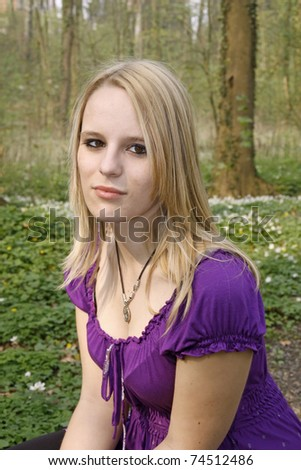 Young blond girl in a deciduous wood in spring, Germany, Europe