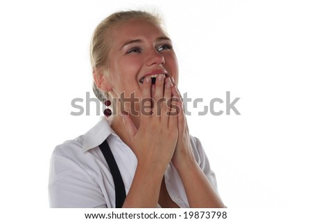 Young blond girl is crying from happiness - stock photo