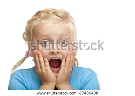 Young blond girl looks shocked at camera. Isolated on white background.
