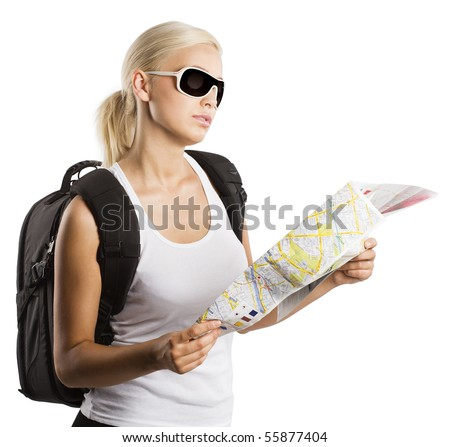 young blond girl with sunglasses looking at map isolated on white - stock photo