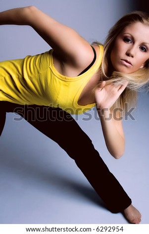 young blond hair woman in dance position - stock photo