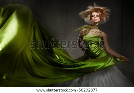 Young blond lady posing - stock photo