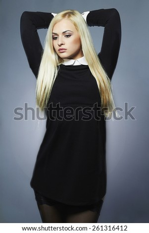 Young blond sexy woman.Beautiful Girl in schoolgirl uniform - stock photo