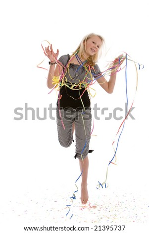 Young blond teenager jumping for joy on her birthday - stock photo