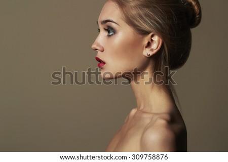 Young blond woman.Beautiful blonde Girl.close-up profile - stock photo