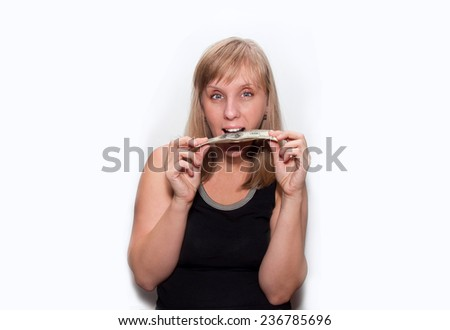 young blond woman counts money dollars isolated - stock photo