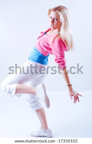 young blond woman dancing, studio shot on white - stock photo