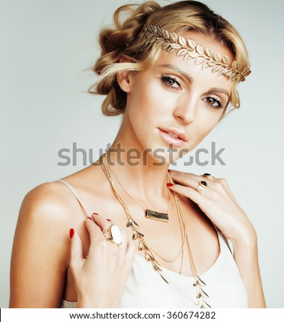 young blond woman dressed like ancient greek godess, gold jewelry close up isolated - stock photo