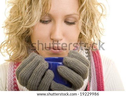 Young blond woman drinking hot tea - stock photo